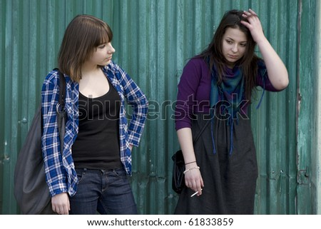 two serious  teen girls have a conversation