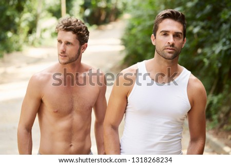 Two seriously handsome dudes looking away