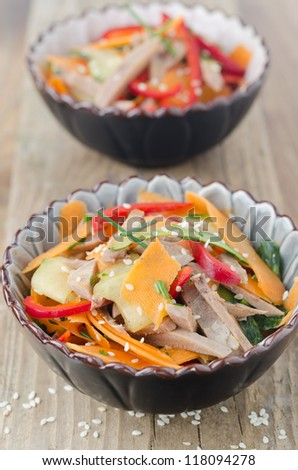 Two servings of salad with peppers, cucumber and beef tongue