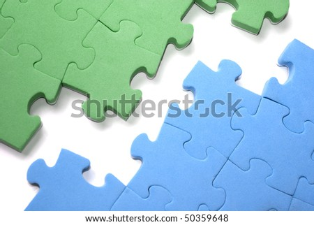 Two sets of blue and green puzzles with space between them