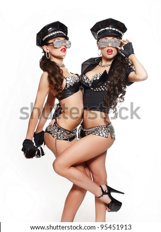 two sexy beautiful  brunette semi nude police women with long curly hair with handcuffs in fashion glasses with bright makeup and red lips isolated on white