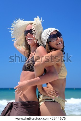 stock photo : Two sexy fit and tanned young girls or friends playing on a