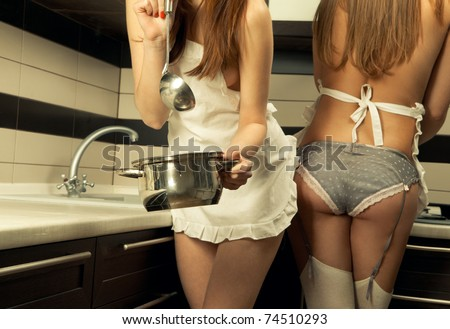 Two sexy housewifes in kitchen room