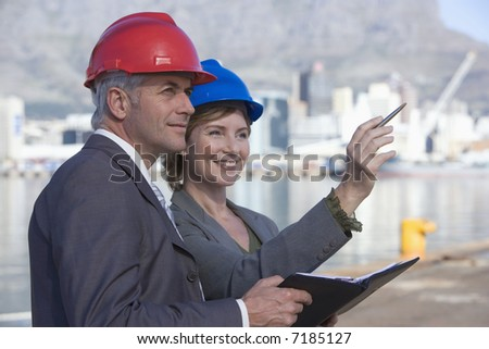Two shipping engineers in the harbor