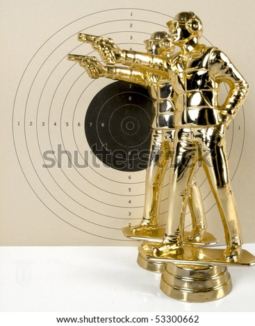 Two shooters aiming against a large target background. See all firearm-related photos from this collection at: http://www.shutterstock.com/sets/22007-guns.html?rid=70583