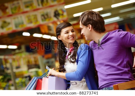 Two shopaholics chatting after good shopping in the mall
