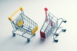 two shopping carts - business metaphor - trade war, rivalry of markets, competition concept