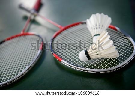 two shuttlecocks and badminton racket.