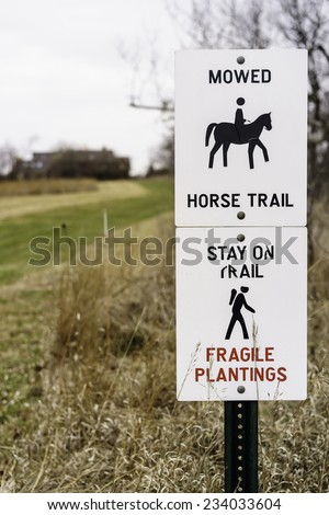 Two signs posted by a horse trail in a county park, autumn in northern Illinois, USA (foreground focus with shallow depth of field) Stock photo ©