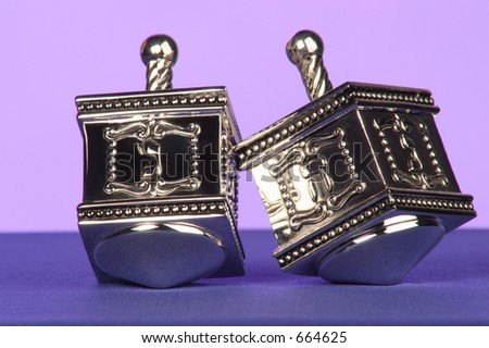 two silver dreidels a traditional Jewish game