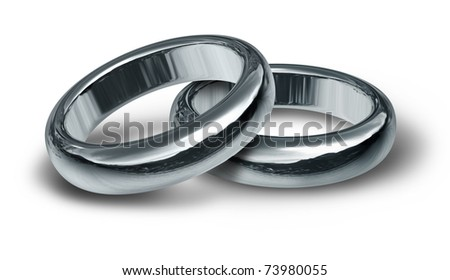 stock photo Two silver wedding rings resting on an isolated background