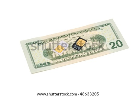 Two SIM cards for cellular phones on dollar bill isolated