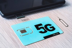 Two sim cards, phone and computer. 5G - the fifth generation of mobile communications