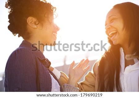 two sisters having fun around town #179690219