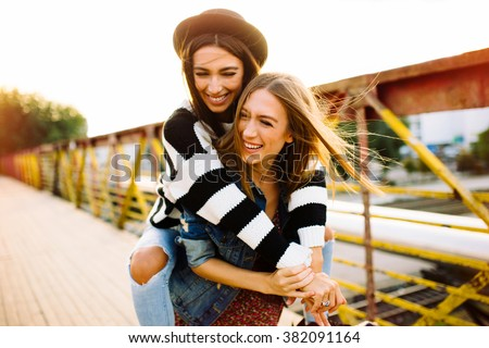 Two sisters having fun outdoor