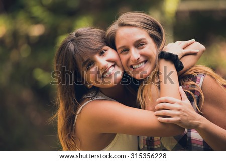 Two sisters hugging each other with love.