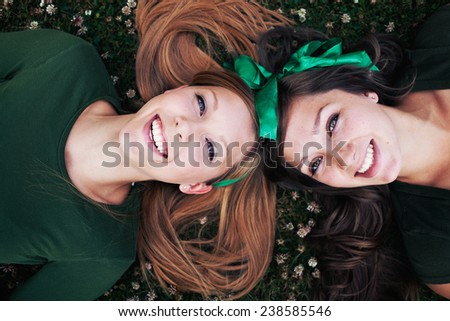Two sisters in green on grass, st patricks day