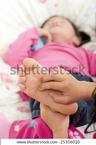 stock-photo-two-sisters-playing-on-the-bed-tickling-feet-25106020.jpg