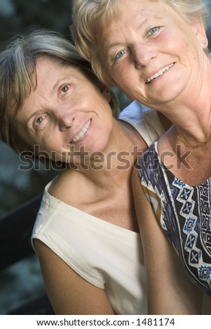 Two sisters smiling. Focus on the lady on the right side.
