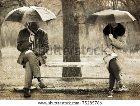Two sitting at bench in rainy day. Photo in old image style.