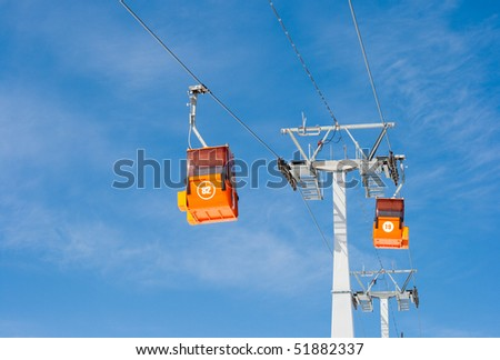 Two ski lift cable cars
