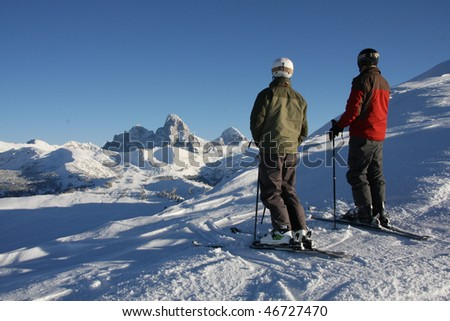 Two skiers view the Tetons