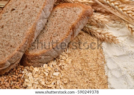 Shutterstock Two slices of bread with fresh ears wheat, dry beans of wheat, flour, integral wheat flour and wheat flakes. Concept of raw material to the finished product. Healthy organic food. selective focus