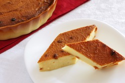 Two slices of cheesecake with raisins