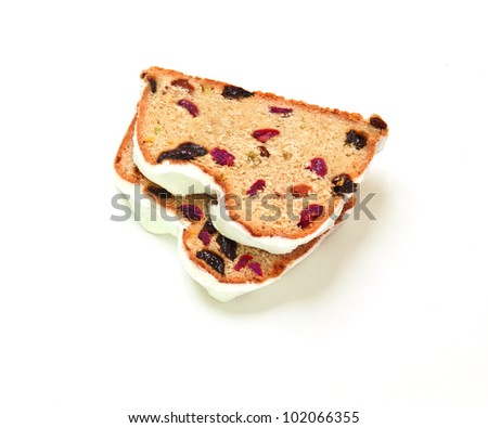 Two slices of Christmas stollen on a white background