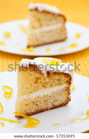 Two slices of lemon cake with rind on a white plate