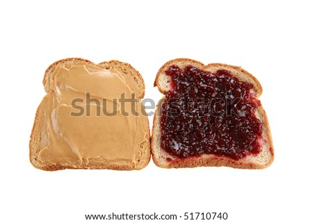two slices of whole wheat bread with peanut butter and raspberry jelly isolated on white