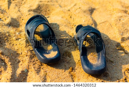 two Slippers on the sand on the beach under the bright sun, the concept of vacation, vacation, vacation #1464320312