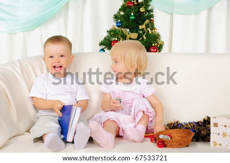 two small children - a boy and girl getting ready for the holiday. Happy New Year!