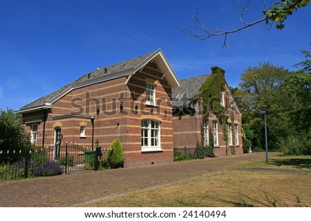 Two small Dutch houses with a garden and fence (City: The Hague)