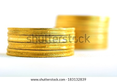 Two small Golden gold coins stacks isolated on white background. Concept photo of bank, money, banking, finance, economy,  saving and loans (Isolated on white background)