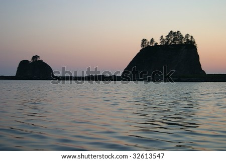 Two small islands off the Washington coast on the La Push Indian Reservation in silhouette.