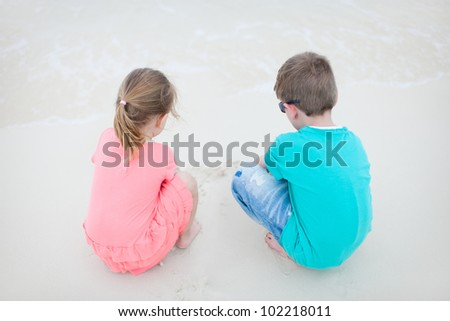 Two small kids at exotic beach