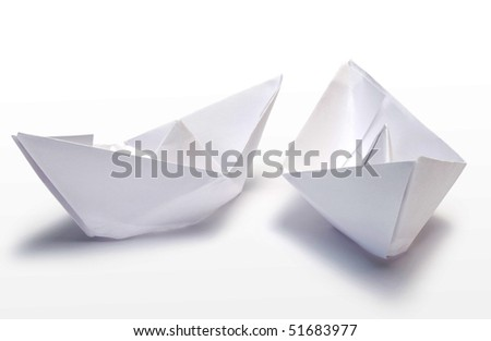 Two small paper ships on white background