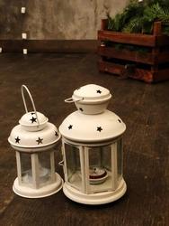 two small winter lightsticks. winter lighthouses.