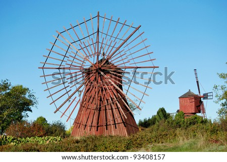 Two small wooden windmills in old city park