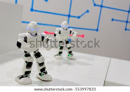 Two Smart Robot dancing. Focus on near the robot