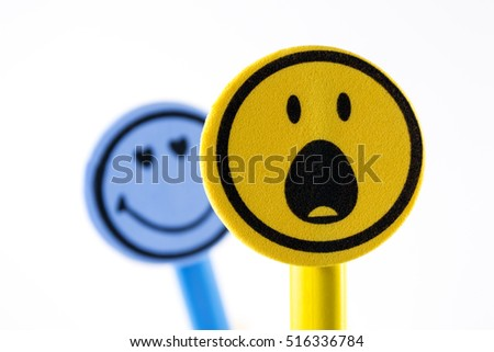 Two smiley faces (blue and yellow) representing a stalker and a victim. Can also represent sexual harassment #516336784