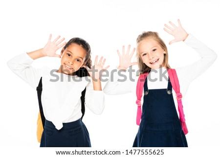two smiling multicultural schoolgirls showing chalk stained hands  isolated on white isolated on white #1477555625