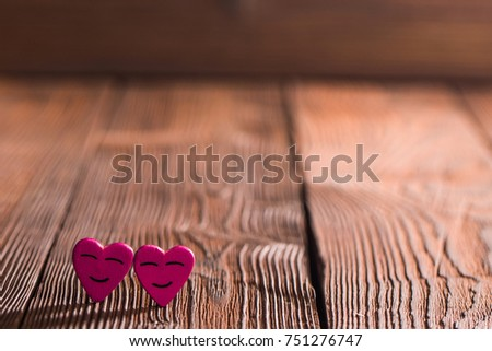 Two smiling pink hearts on wooden background, relationship valentines day concept #751276747