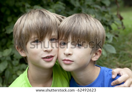 stock photo : Two smiling twin brothers outdoor portrait