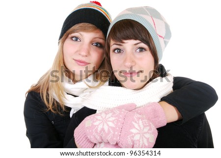 two smiling women in winter clothes - stock photo