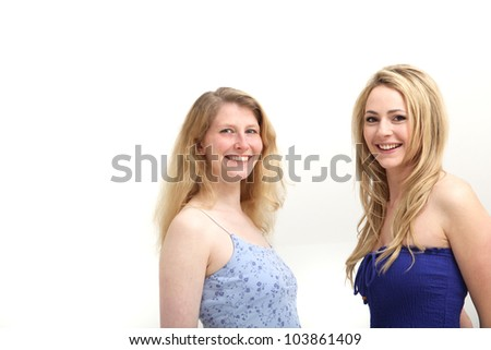 Two smiling women Two smiling women posing on white background