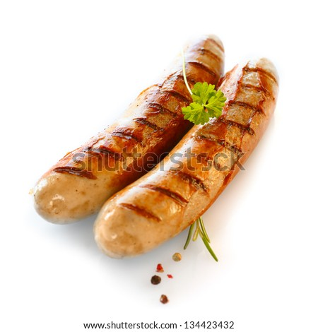 Two smoked sausage against the white background