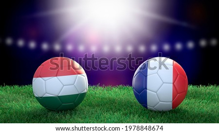 Two soccer balls in flags colors on stadium blurred background. Hungary and France. 3d image Сток-фото ©