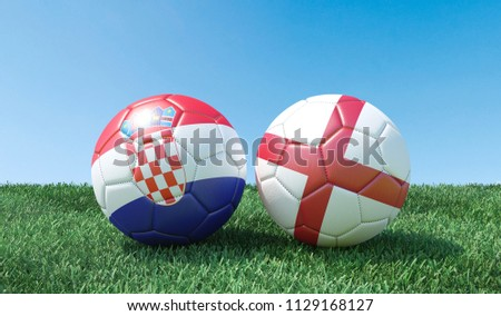 Two soccer balls in flags colours on green grass. Croatia and England. 3d image